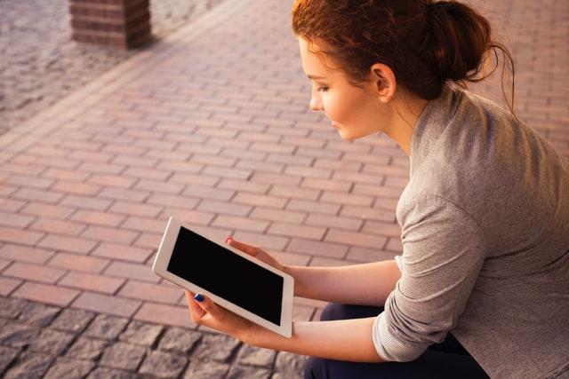woman reading blog